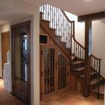 Stair case with wine cellar below. Crafted from reclaimed old growth redwood.