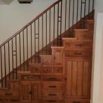 Custom cabinetry under stairs.