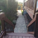 Composite decking with stone pathway.