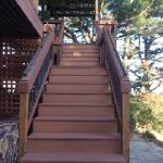 Composite decking with copper handrails.