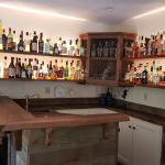 Custom bar with reclaimed redwood.