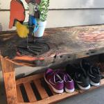 Porch bench with shoe rack. Crafted from reclaimed wood.